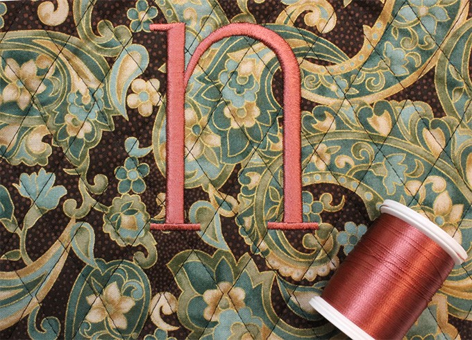 I was pleasantly surprised at how wonderfully the Sulky Rayon in Deep Mauve looks on this teal and brown paisley print
