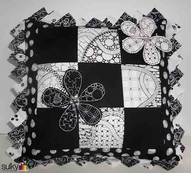 In Eric's class, you will get the instructions for this pillow and the applique pins!