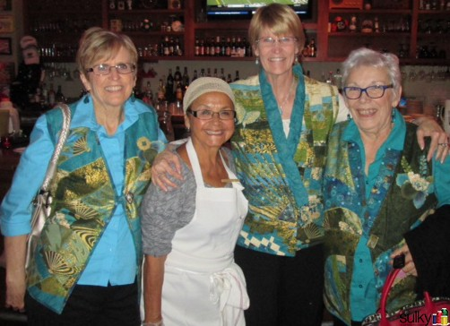 Another tradition these ladies have is to go to the same restaurant every year on the first day of Festival. The staff love seeing the new vest every year too! Here they are with one of their friends fomr the restaurant in 2013 vests.
