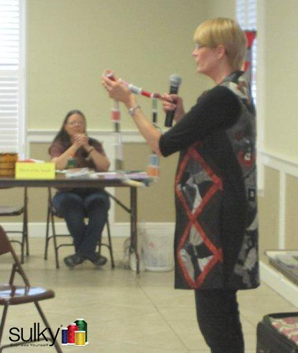 Nancy Sapin wearing her Vest while teaching a thread class