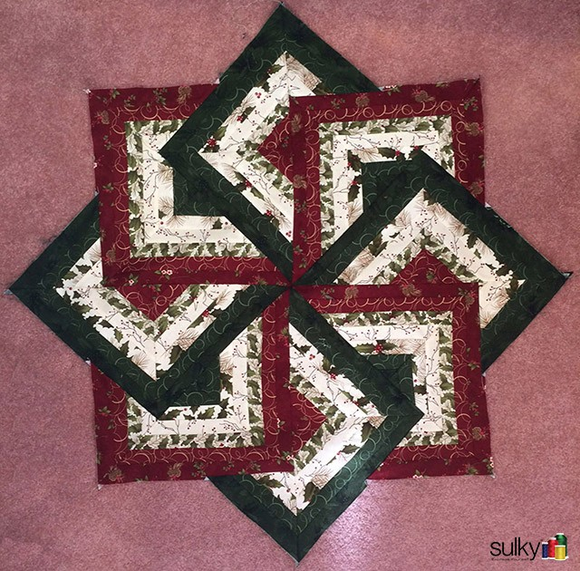 This fabulous table topper was Carol Ingram's last project.