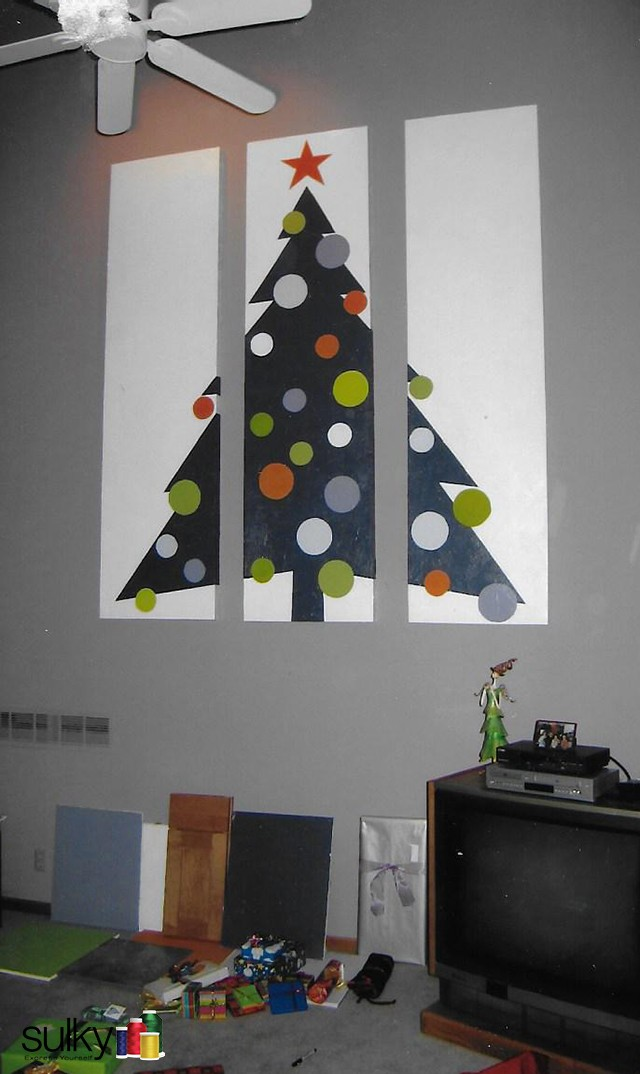 A few years ago, Diane and her hubby were remodeling their home at Christmastime, so her husband made a Christmas tree out of Drywall! He painted in the colors they palnned to redo the house in to make sure they were the colors that they wanted to choose. How clever!