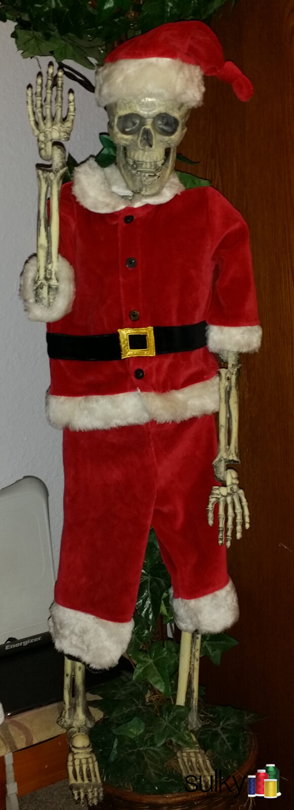 But Eric said it's not Christmas until the skeleton is dressed!