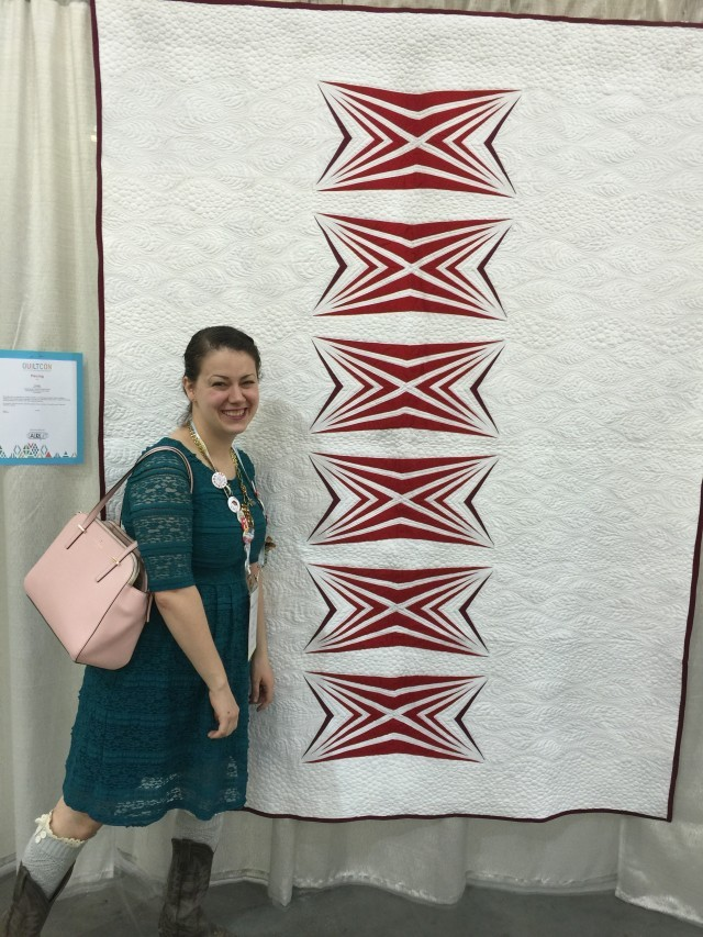 Amy Garro of 13spools.com with her quilt at Quiltcon 2016