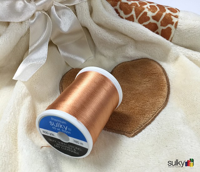 Pick your thread. I used Sulky 40 wt. Rayon that matched the heart on giraffe's chest.