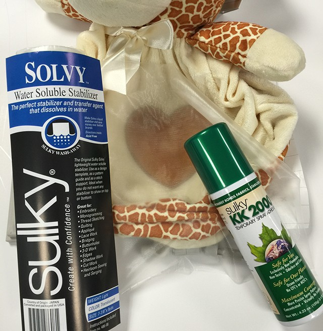 Spray KK 2000 to the back of a piece of Sulky Solvy and put over the top of the heart.