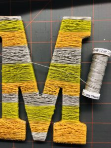 Cotton Thread Wrapped around Wooden Letter