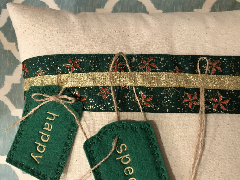 embroidered tags on christmas pillow