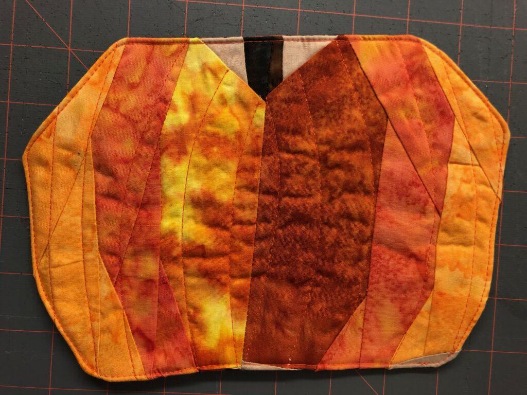 paper pieced pumpkin with stitching detail