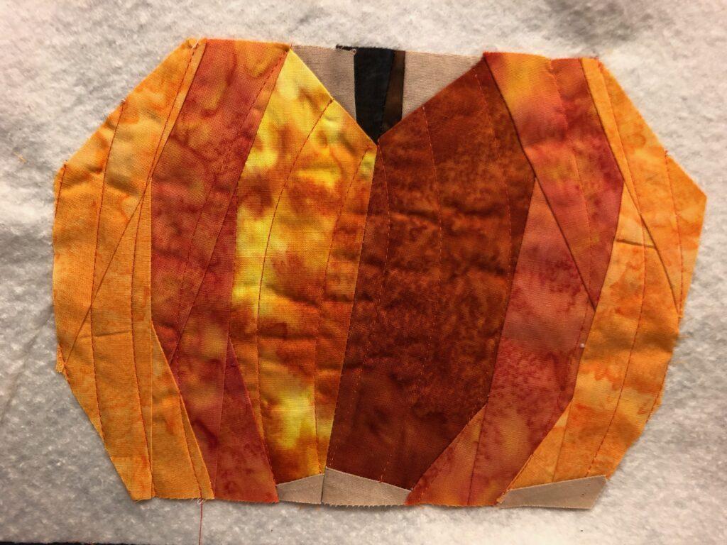 paper pieced pumpkin on batting