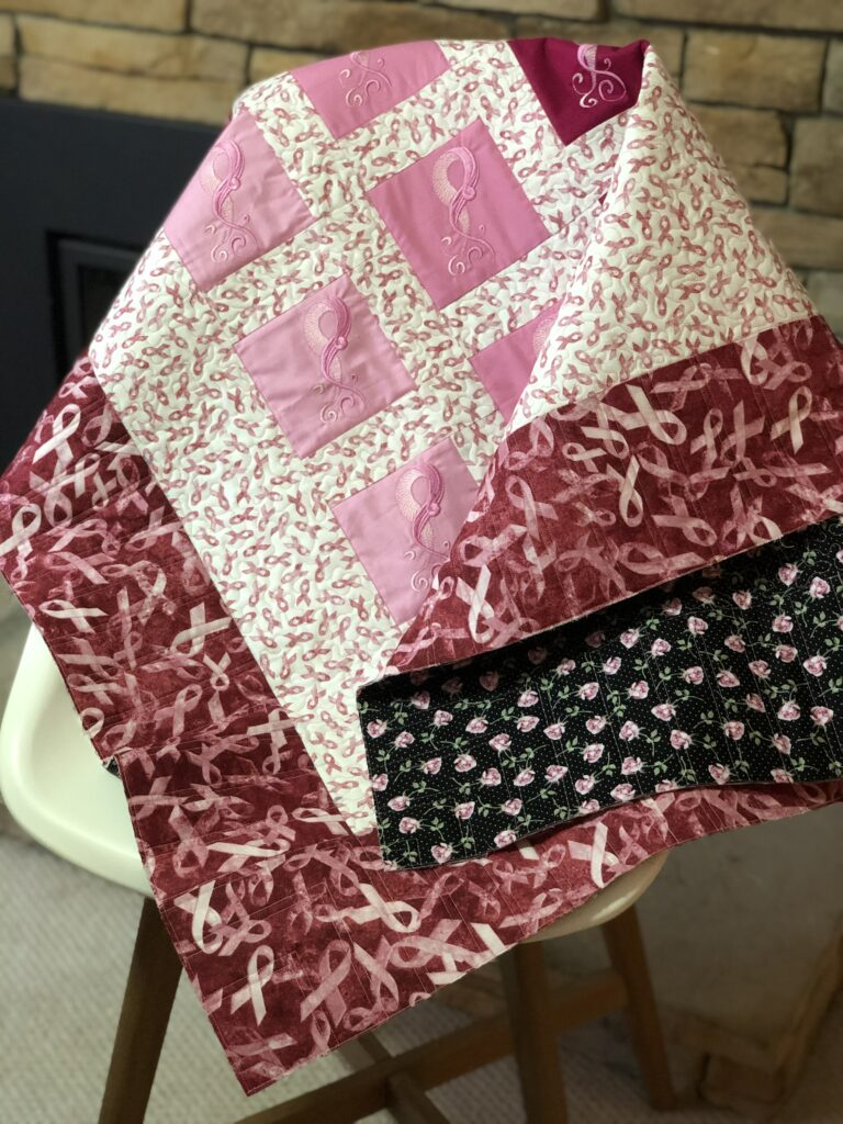 breast cancer quilt with backing showing
