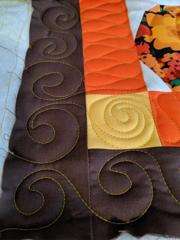 paper pieced pumpkin quilting