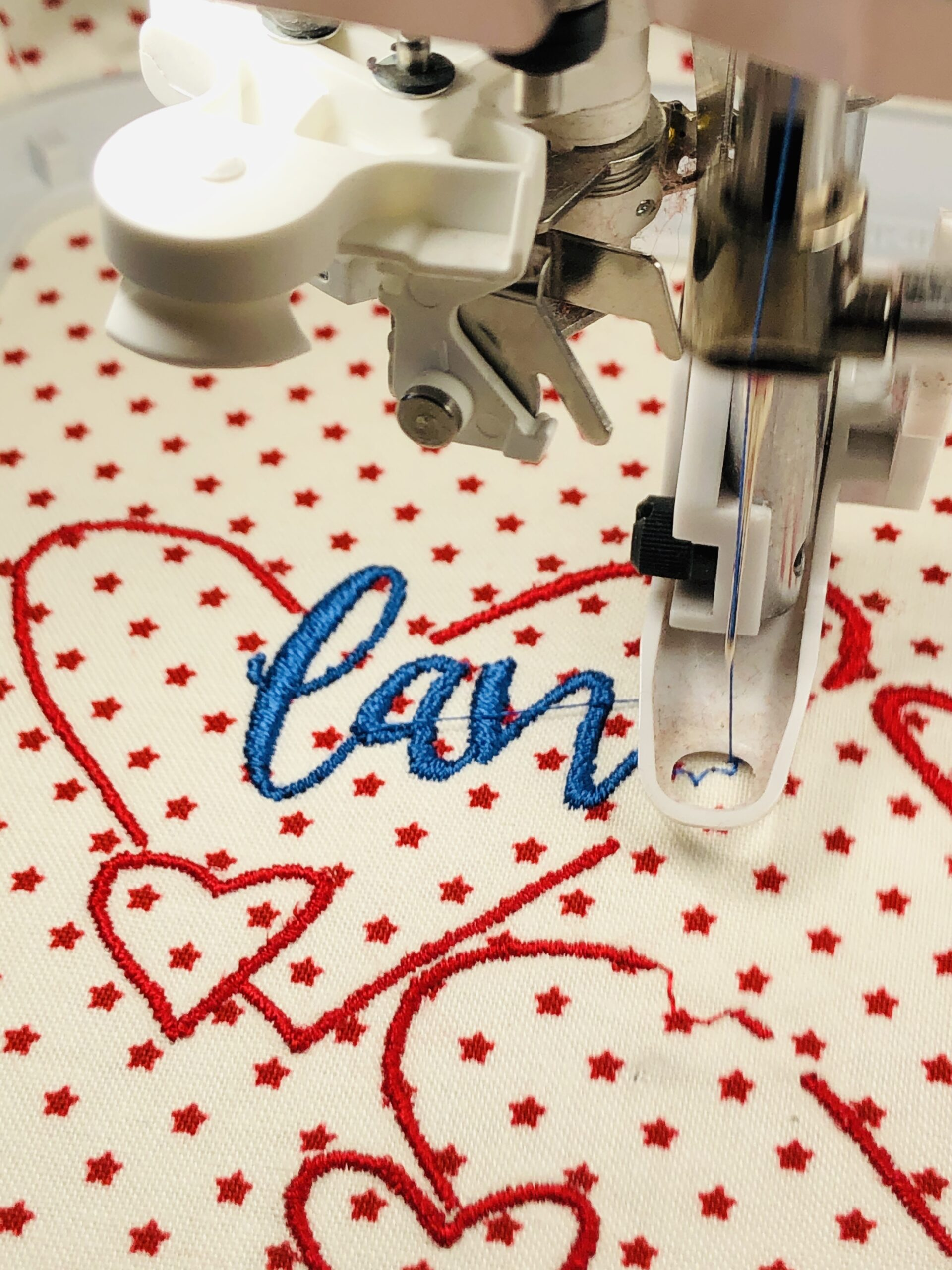 embroidering patriotic pillow