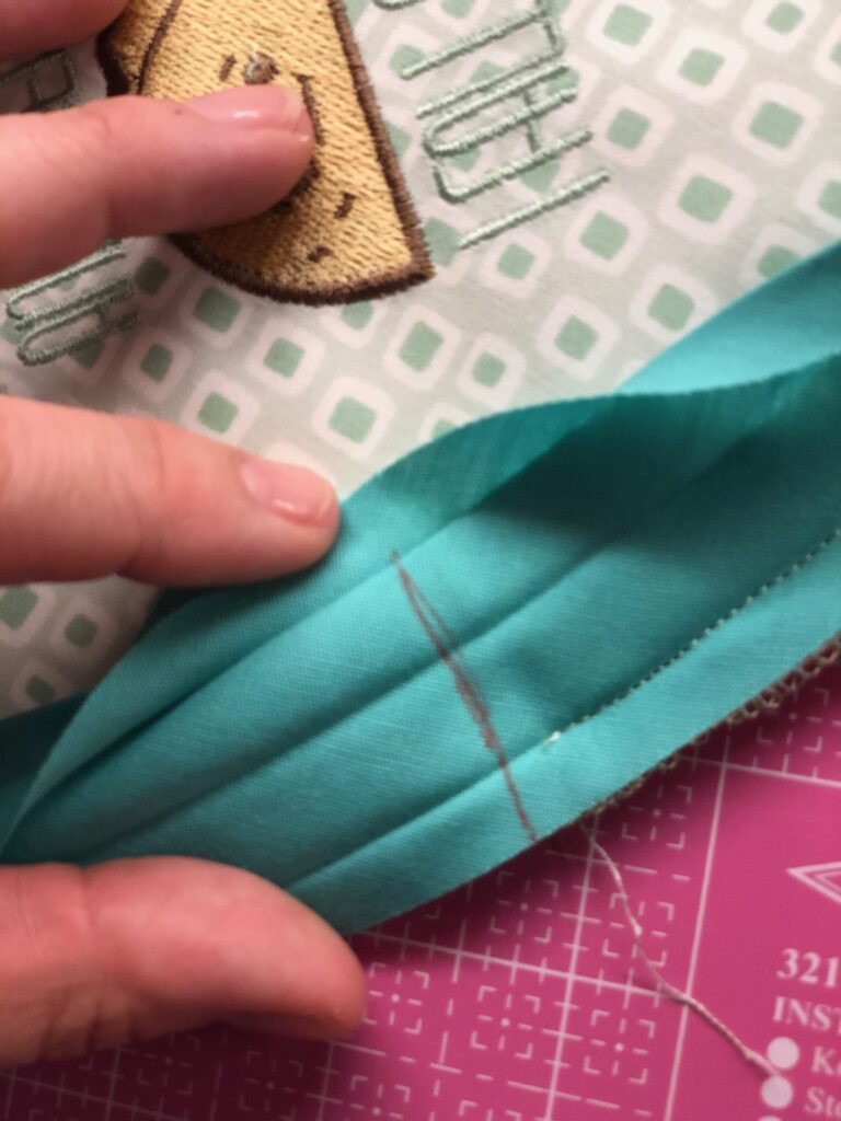 mark binding for potholder