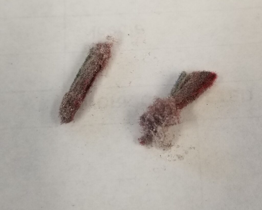 lint from feed dogs - machine maintenance