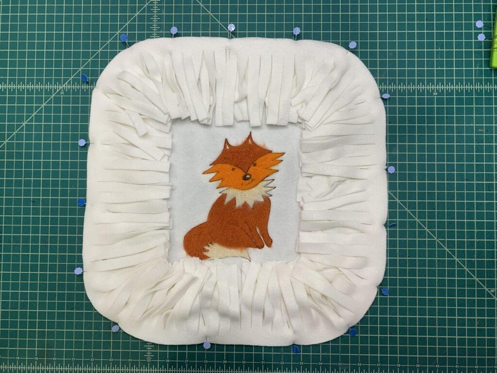 pin fringe to pillow
