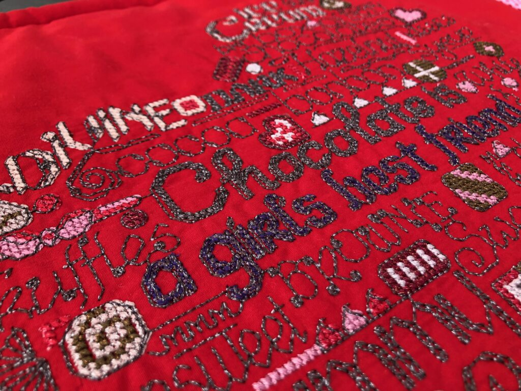 detail of embroidery on table runner