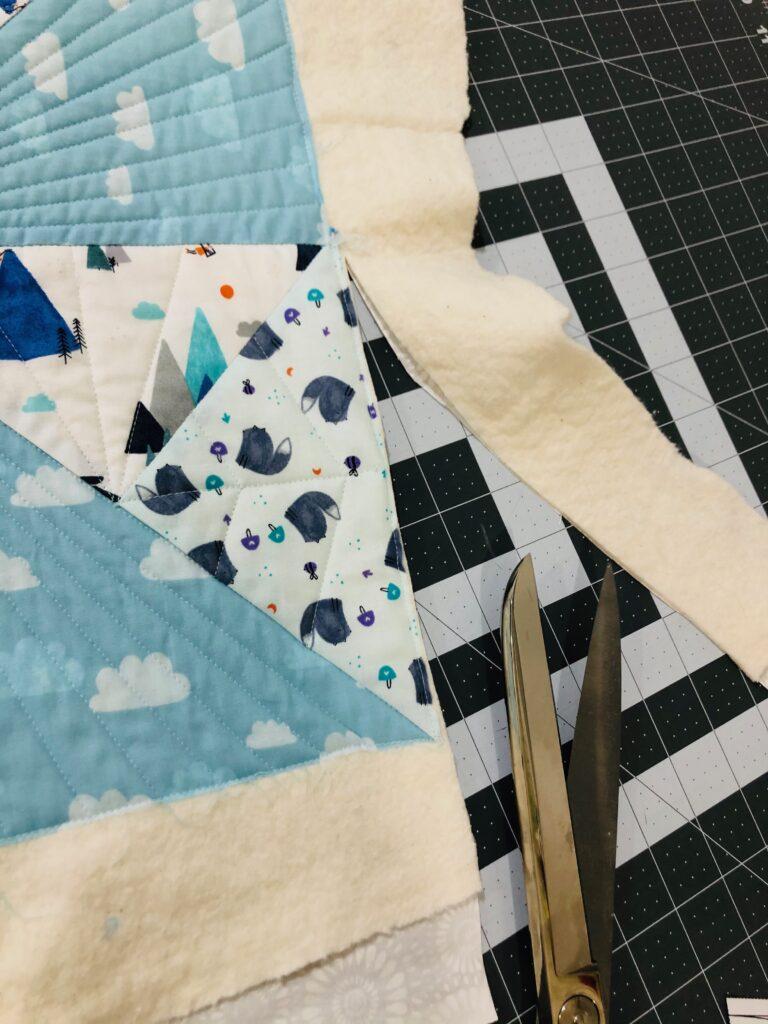 trim baby quilt edges