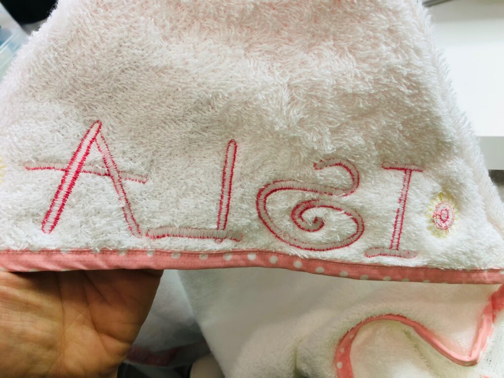 embroidery wrong side on hooded towel
