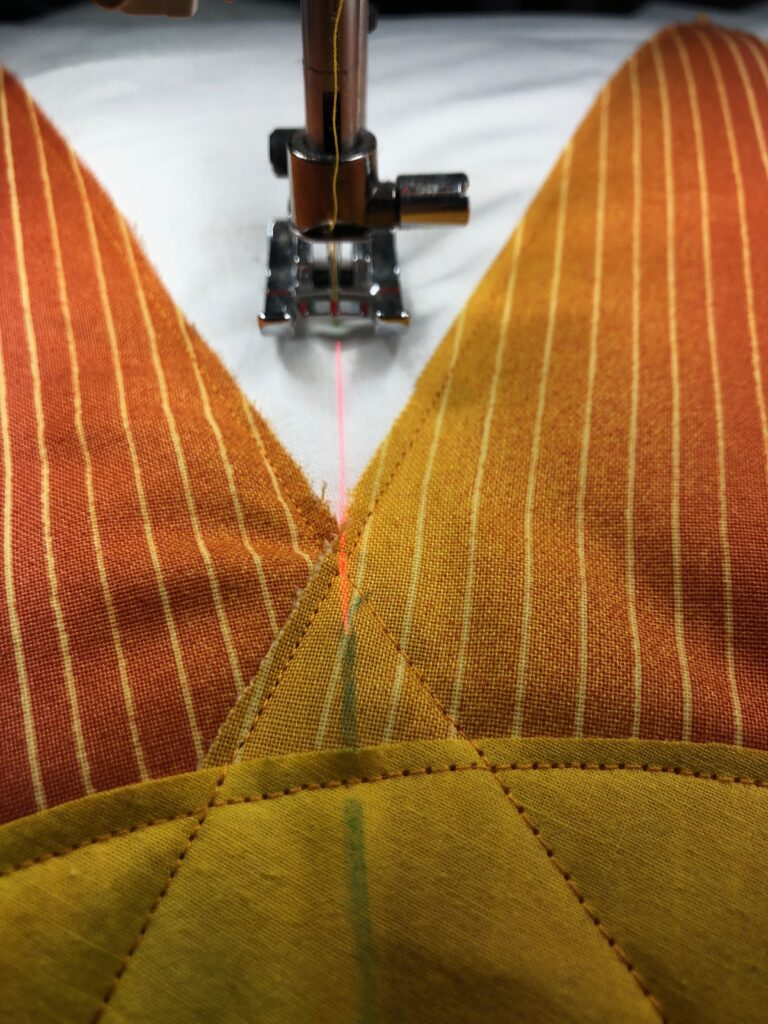 use laser light to aid in straight quilting